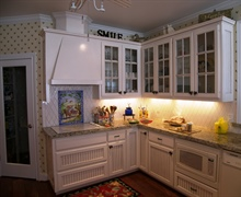 Custom built kitchen cabinets with glazed finish.