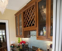 Custom built wine cabinet with granite counters.