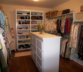 Custom built closet with island dresser.
