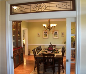 Painted french pocket doors with stained glass and wood transom.