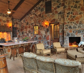 Outdoor kitchen: full masonry fireplace; brick herringbone backsplash.