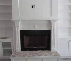 Site built custom cabinets by TCC. 2x4 Ancient tumbled silver tile on fireplace